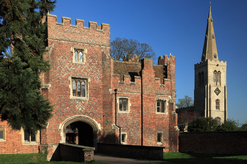 Buckden Towers Gatehouse with St Mary's in the background